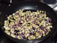 Onions & aubergines diced & cooking