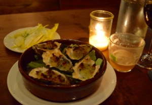 Wood oven baked local oysters with absinthe, breadcrumbs & endive salad
