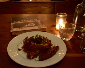 Grilled duck wing confit with pomegranate, chiles & sesame