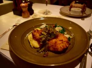Buttermilk- fried northern halibut in stemperata with spinach, mint, almonds, green olives